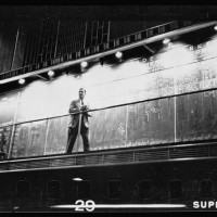 12.-Unidentified-man-standing-in-front-of-a-Trade-board-on-which-he-records-a-Market-Score-at-the-Merchandise-Mart