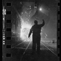 15.-Steel-worker-in-mill-as-molten-steel-spills-from-vat-in-Chicago-Illinois-2