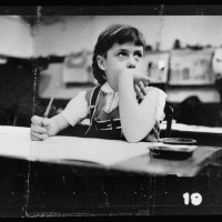 8.-Young-girl-seated-at-desk-in-classroom-in-Chicago-Illinois