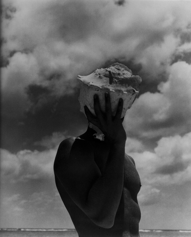 man-holding-shell-photographed-by-herb-ritts