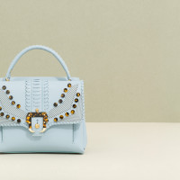 Paula-Cademartori_Fall-Winter-2014-15_Petite-Faye-Hand-Bag_Powder-Blue_Nappa_Lasercut-Studs_detail-1280x822
