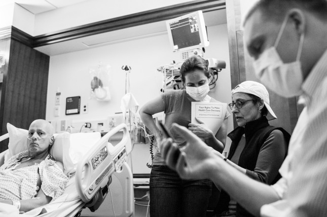 Howard Borowick and his family celebrate the first night of Hannukah in the hospital by talking and singing, interrupted by nurses and doctors taking vitals and administering medication. The next day they celebrated Thanksgiving. Howard would never return home. Greenwich, CT. November, 2013.